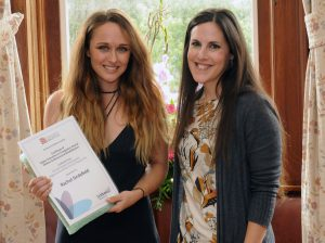 (left to right) Rachel Sirdefield, RSPCA Exeter, receives an award for Highest Overall Mark in the Certificate of Higher Education in Animal Welfare and Rehabilitation course from Helena Tallack