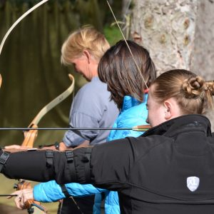 Picture shows veterinary professionals completing archery as an activity at a previous XLVets national meeting